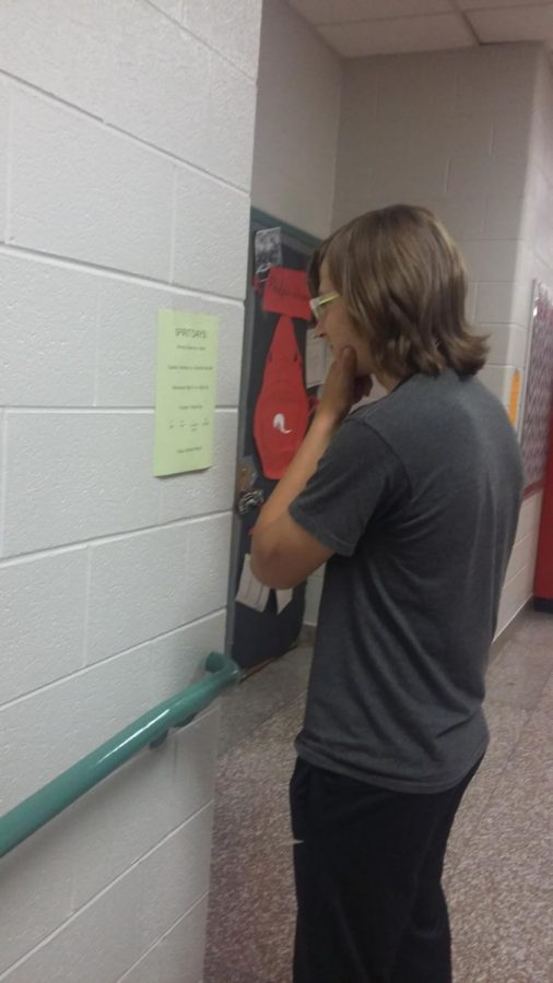 SLHS student browses the spirit week lineup.