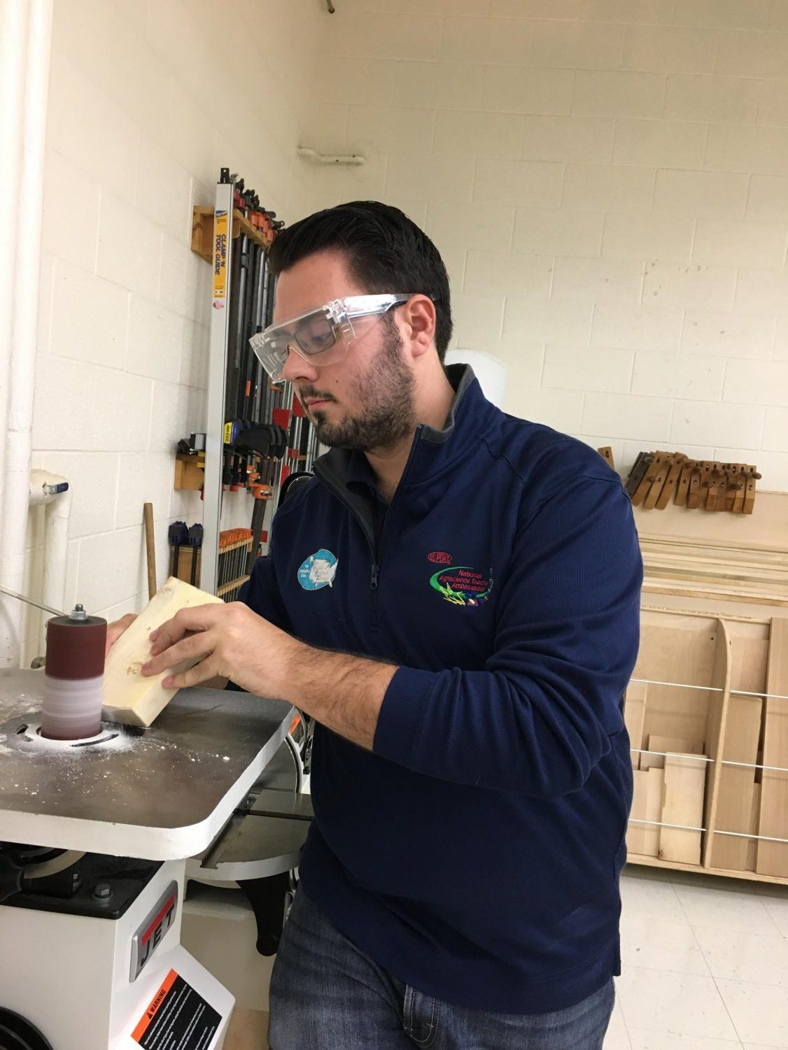 Mr. Bernia works on a project in his shop