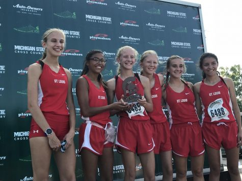 St Louis competitors pose with an award from the Spartan Invite.
