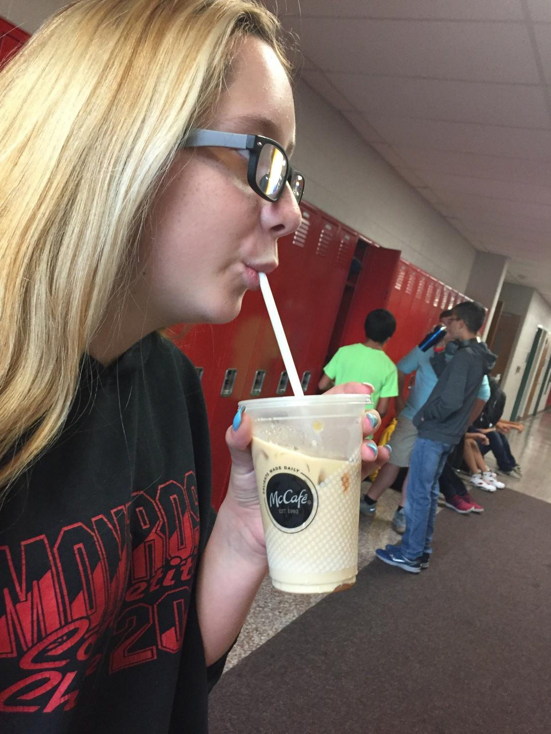 SLHS Student enjoys an iced coffee drink from an outside restaurant.