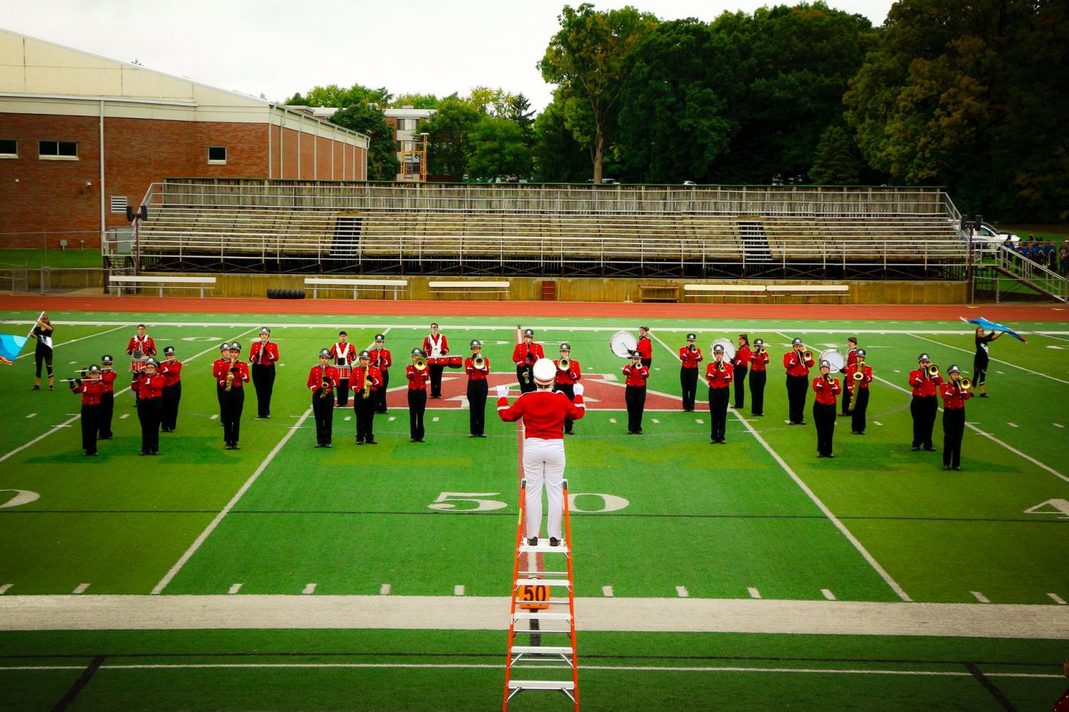 The Saint Louis band performs on a football field.