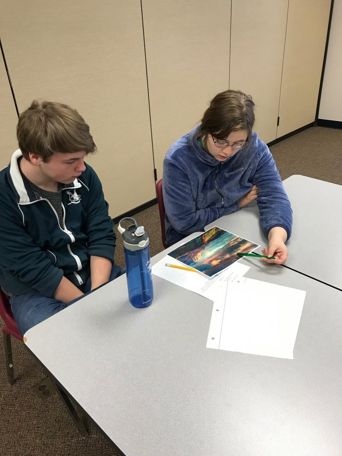 Members of the Language Arts Club work on their submissions.