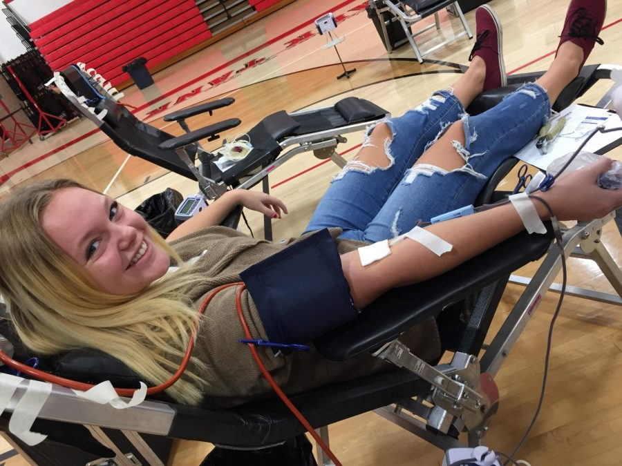 Brie+Kovach+donates+blood+at+the+SLHS+blood+drive.