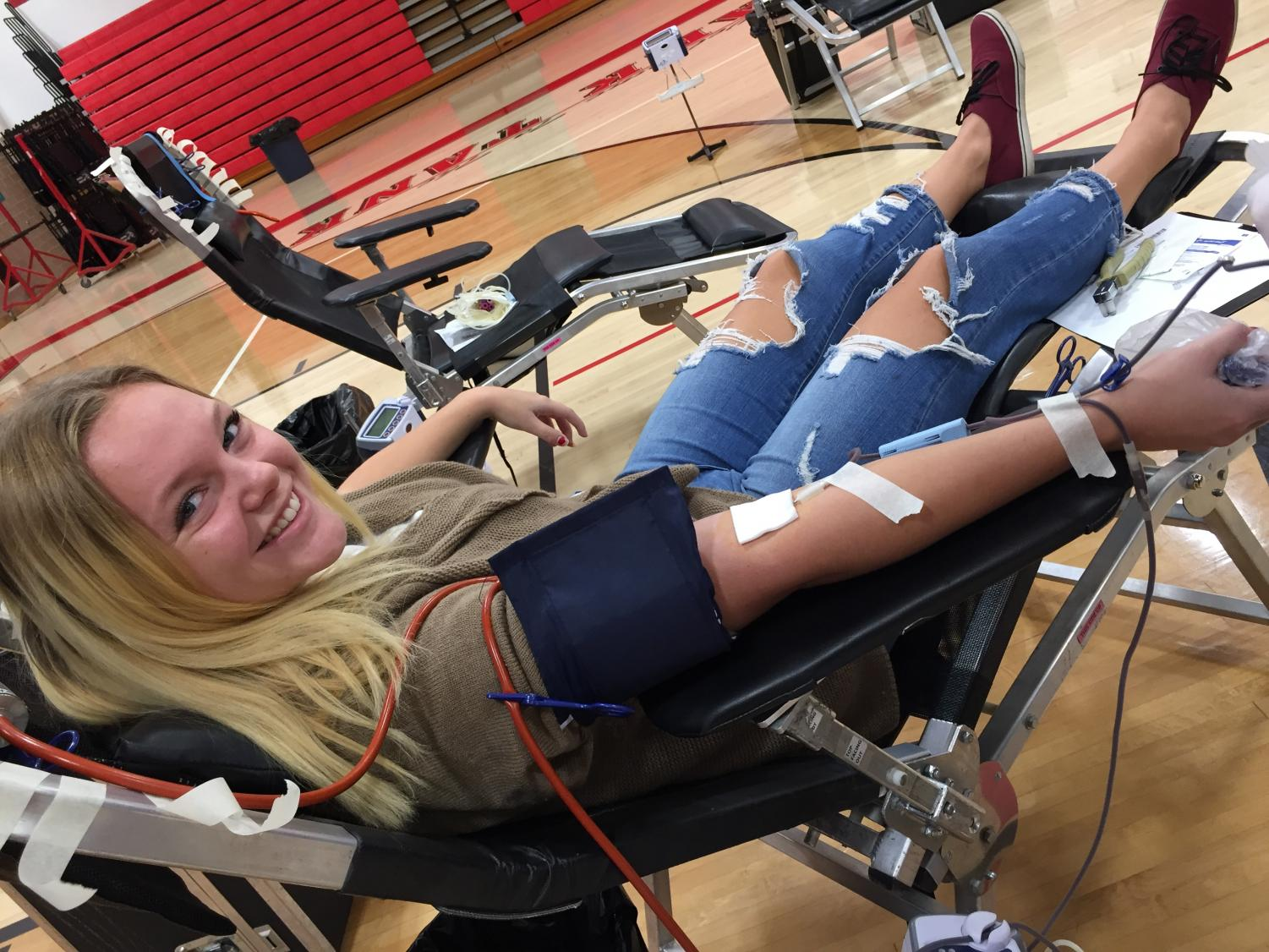 Brie Kovach donates blood at the SLHS blood drive.