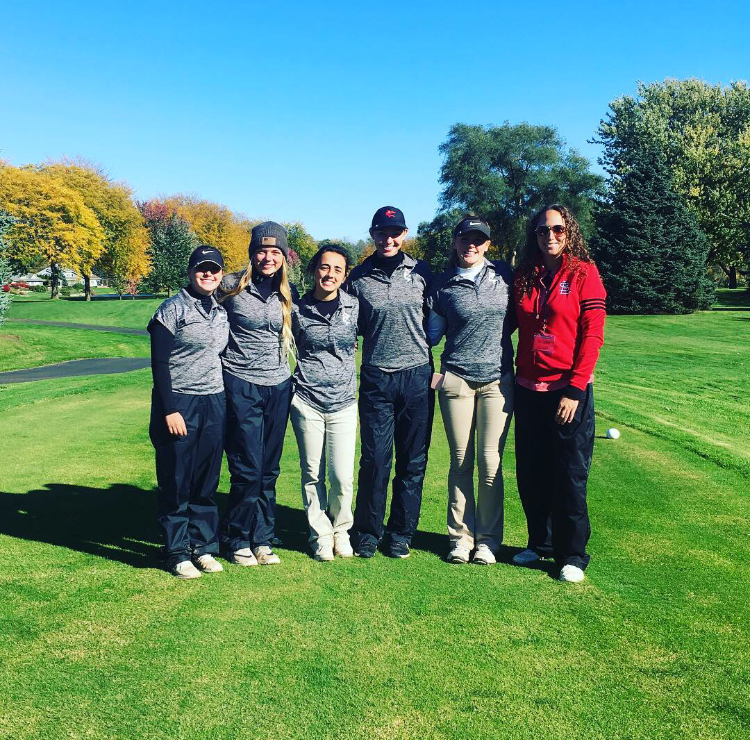 Golf team poses for a photo.