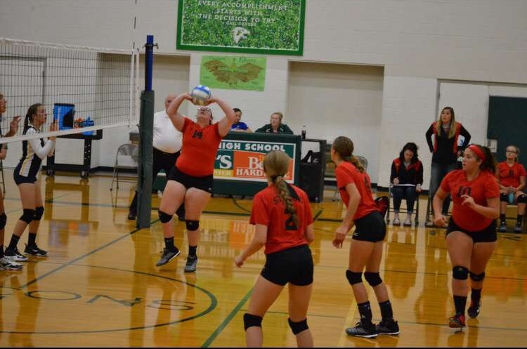 Macie+Salladay+sets+the+ball+for+a+kill.