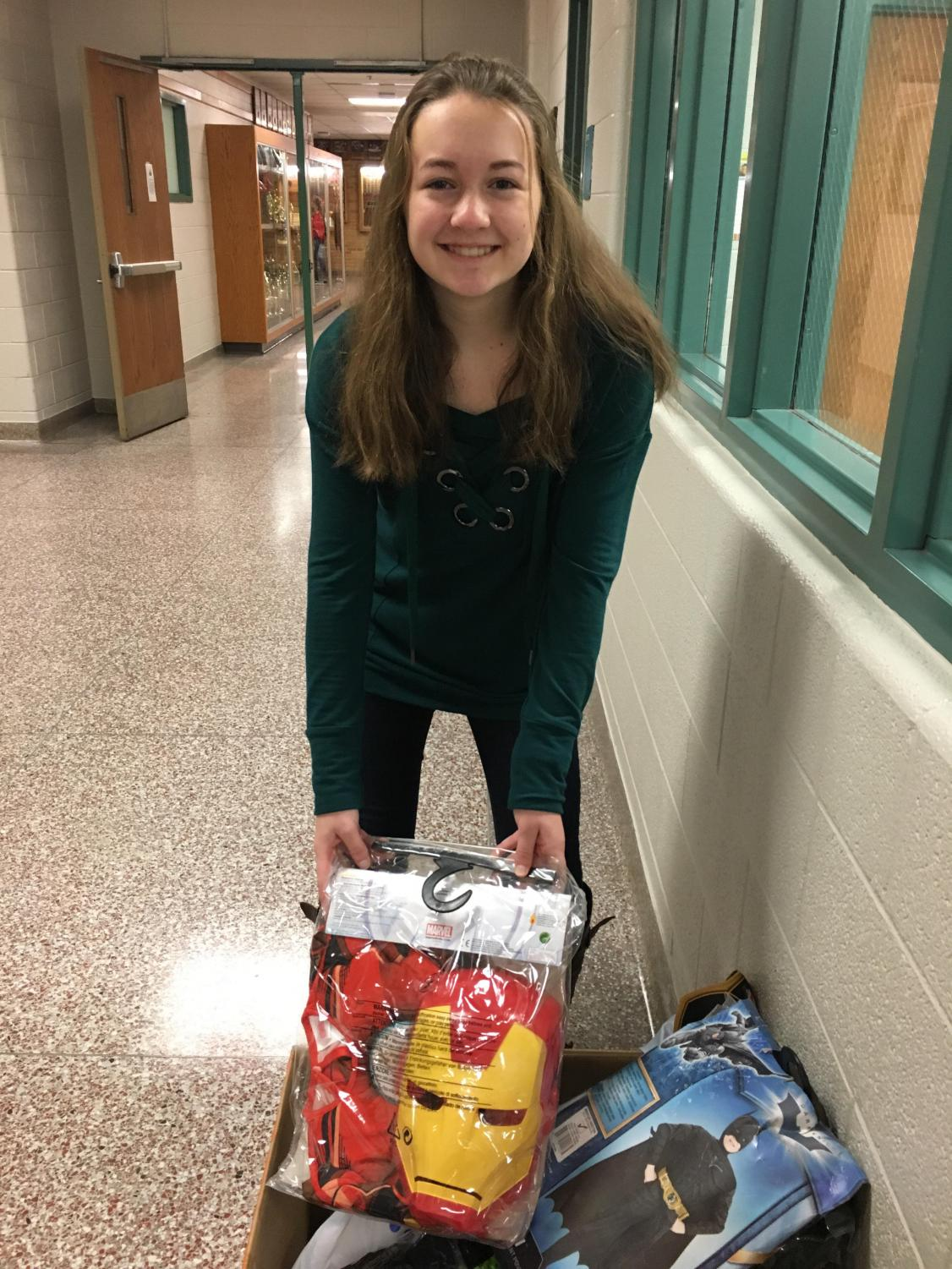Allyse March donates a costume at the high school.