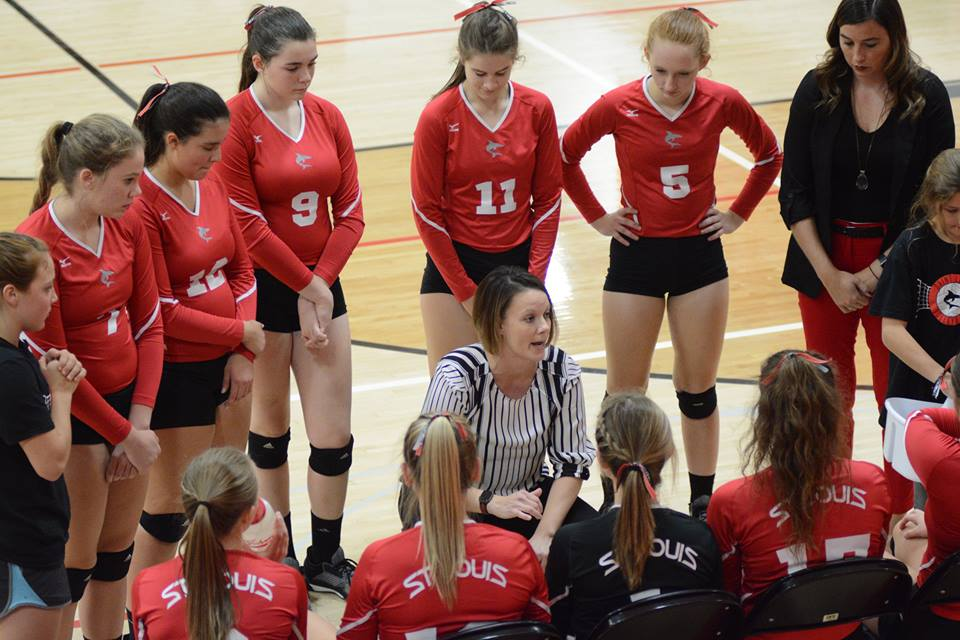 Head coach Jennifer Jaeck (center) delivers advice during a timeout Wednesday night at the Shark Tank.