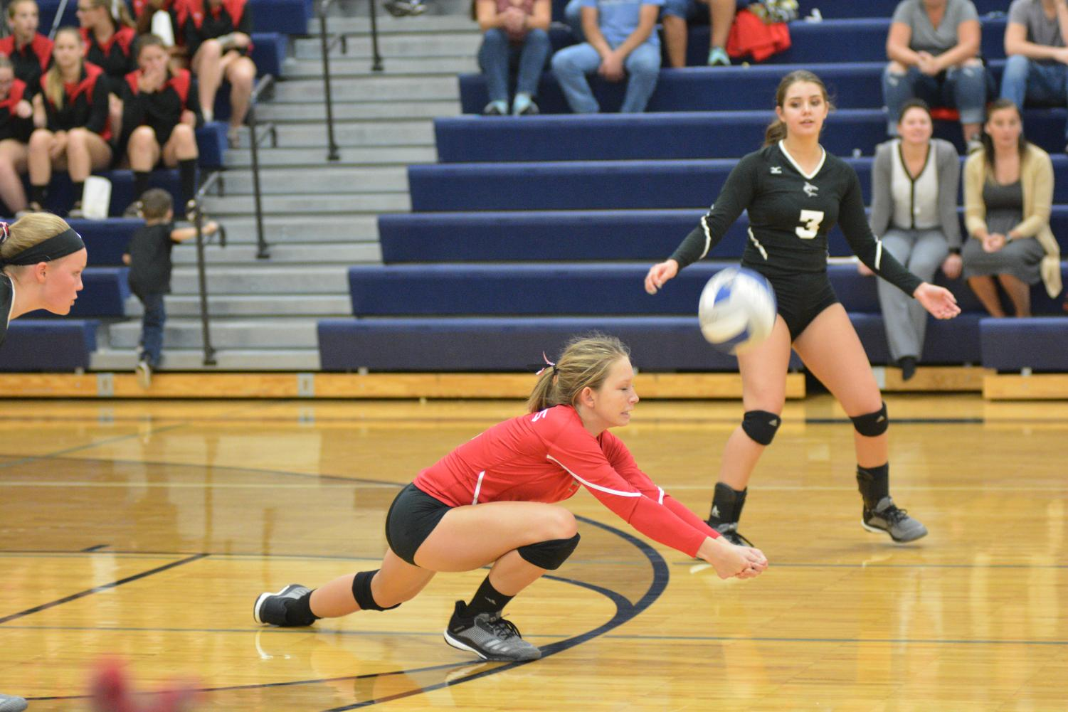 Madeline Greenup digs a ball against Nouvel.