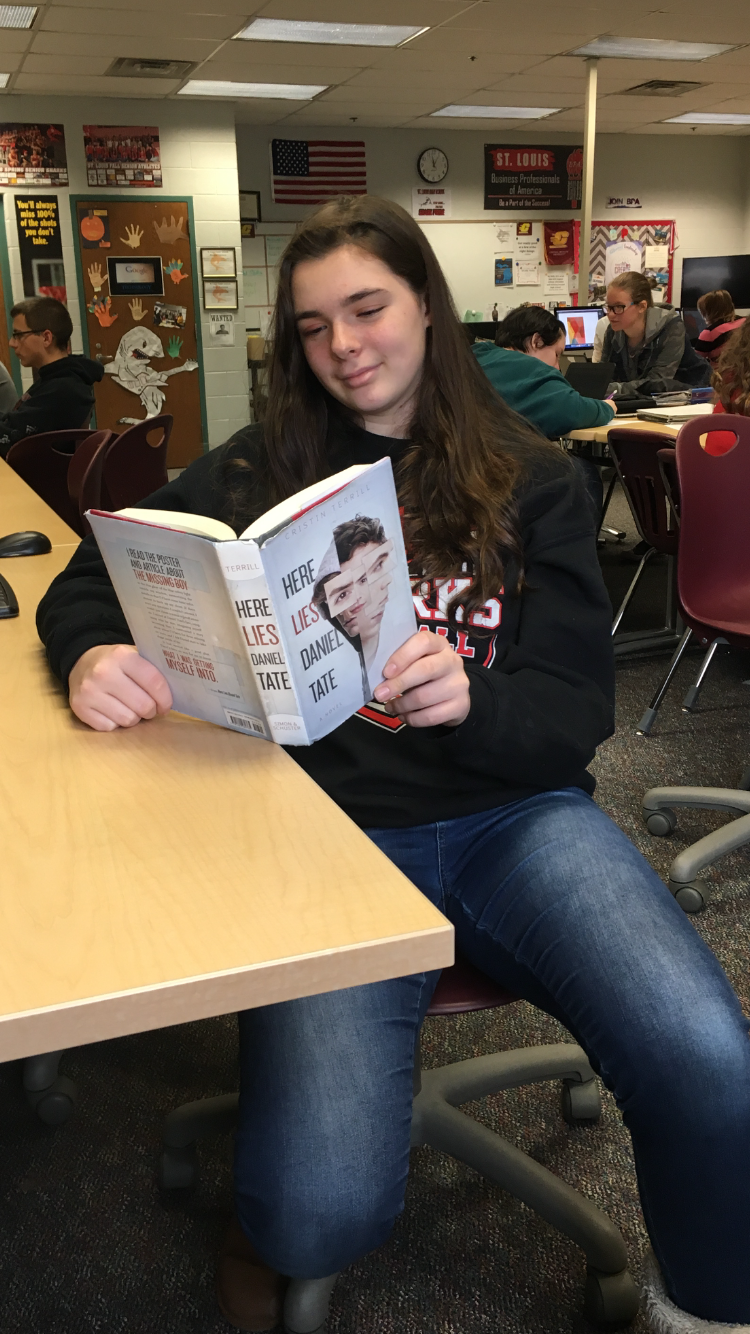 Korah Honig enjoys the captivating read by Cristin Terrill.