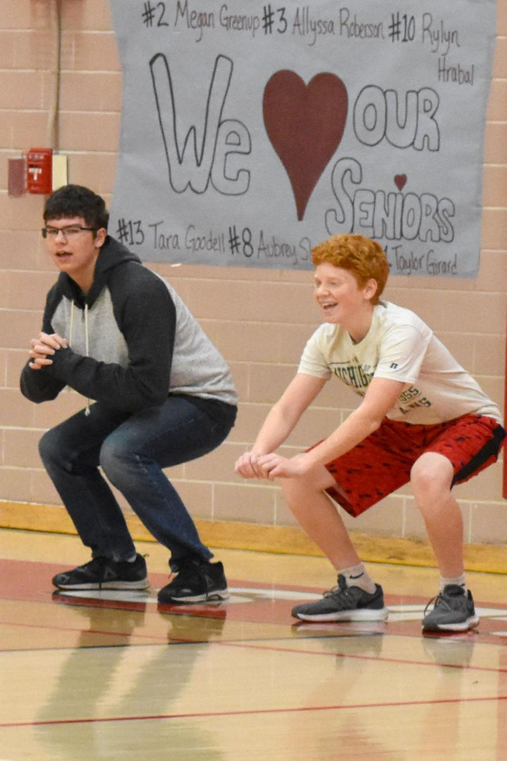 Reece Giles and Zach Starry do squats during the workout.