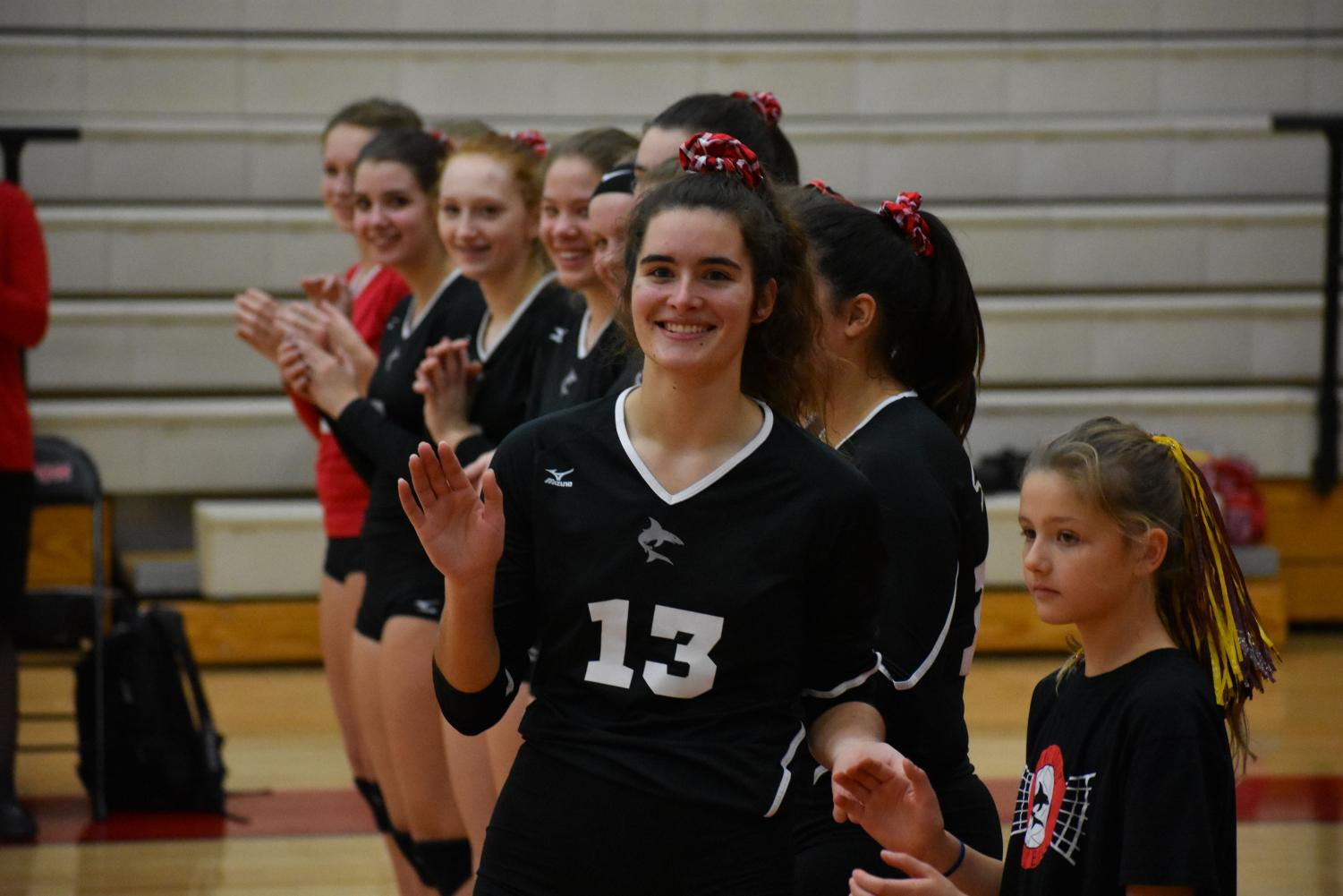 Senior Tara Goodell waves at the crowd before the championship match-up.