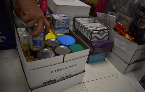 A good Samaritan donates food to help the family in need.