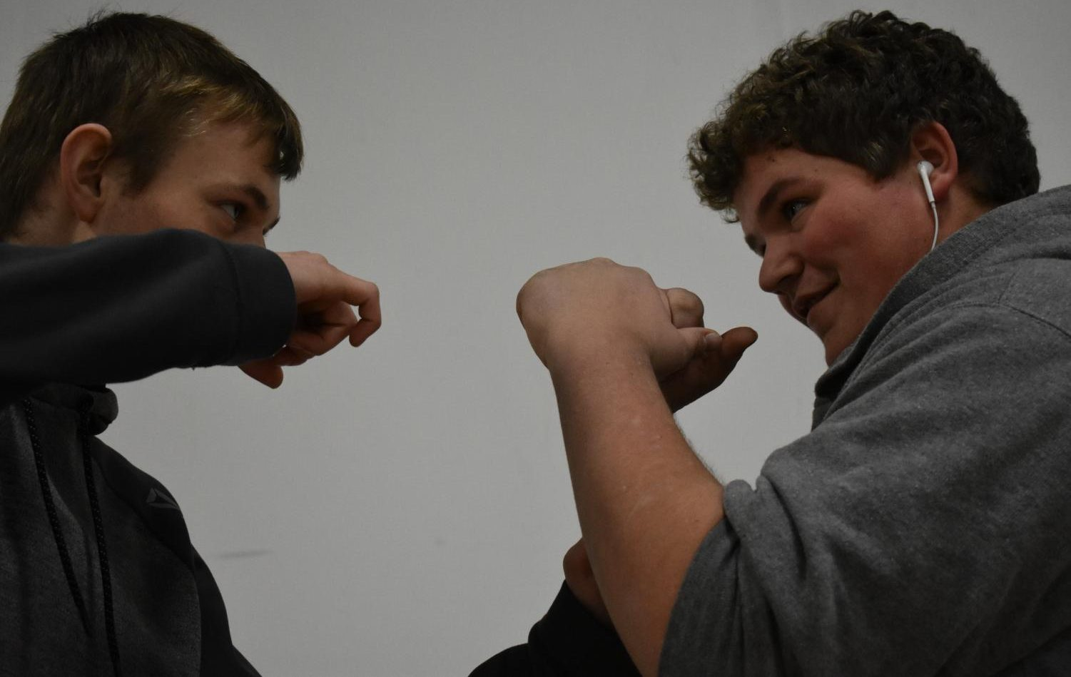 Two SLHS students prepare to practice boxing, inspired by Creed II.