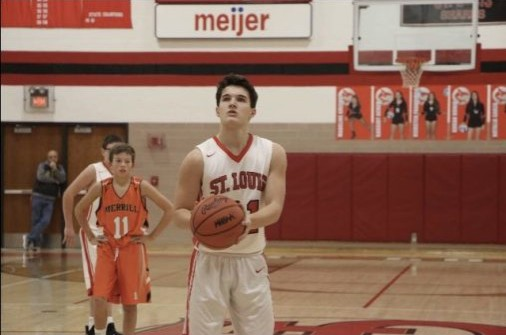 Ethan Wilson prepares to shoot a free throw.