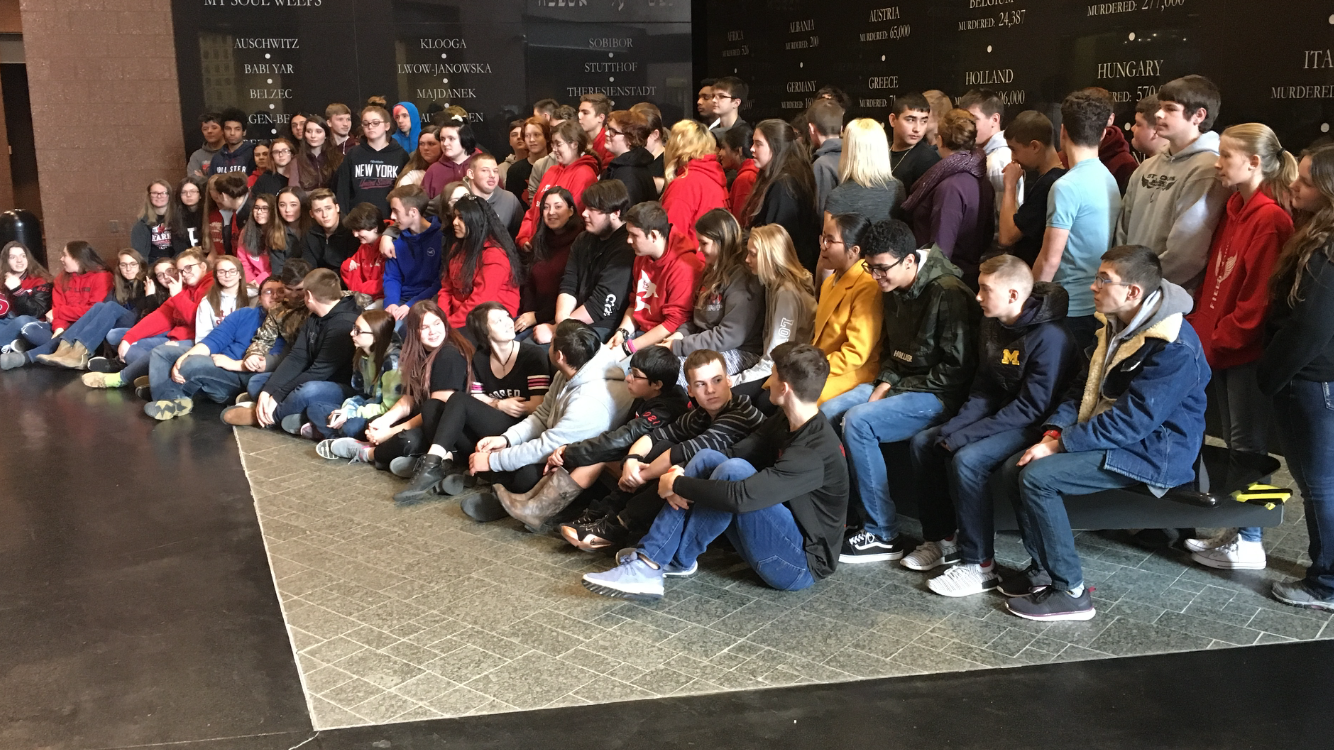 The sophomore class poses for a photo following their museum tour.