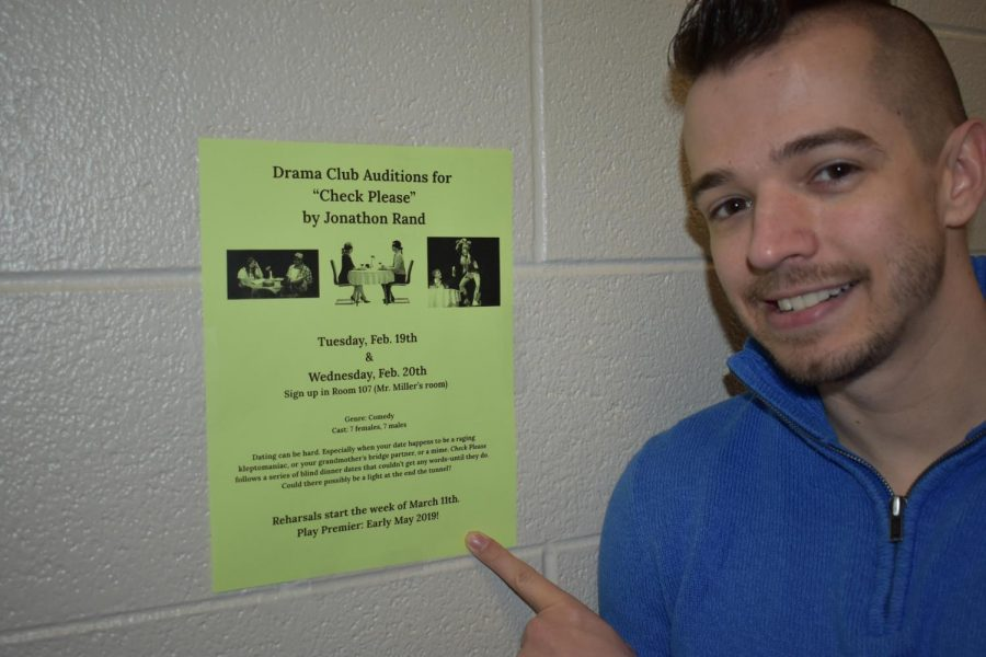 Jordan Miller shows off a flyer for the brand-new drama club.