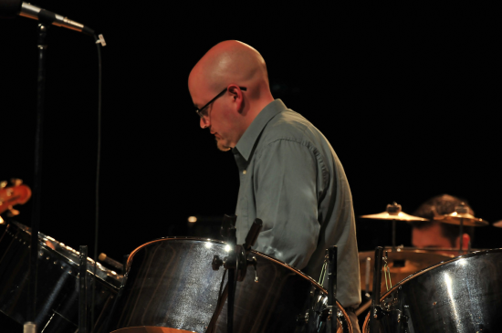 Steve Lawhorne plays the steel drums. He is also the director of the high school steel band.