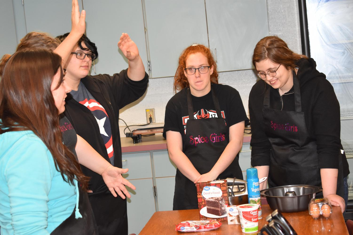 SLHS Spice Girls interact with various ingredients and things.