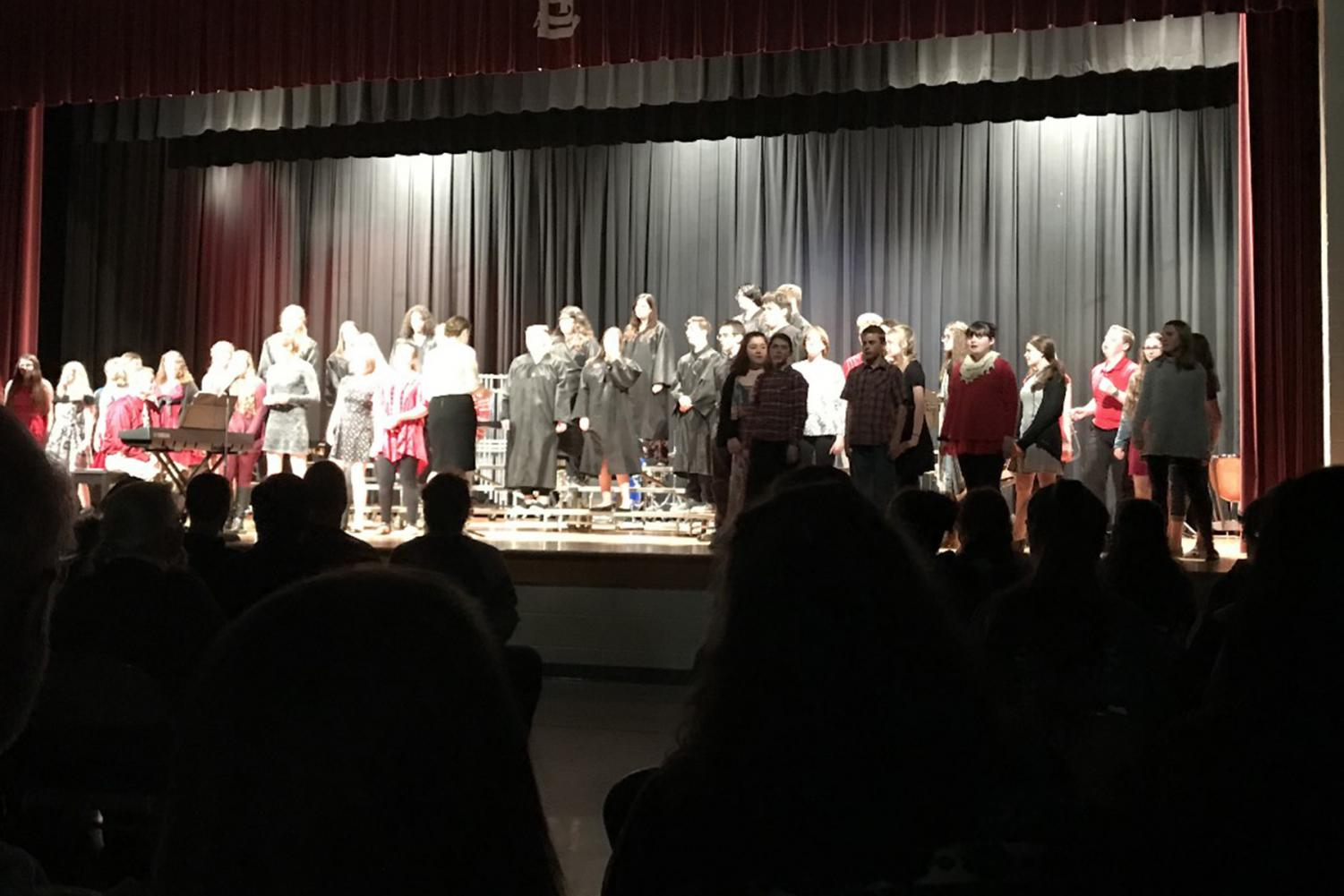 The St. Louis High School Choir performs alongside the middle school choir.