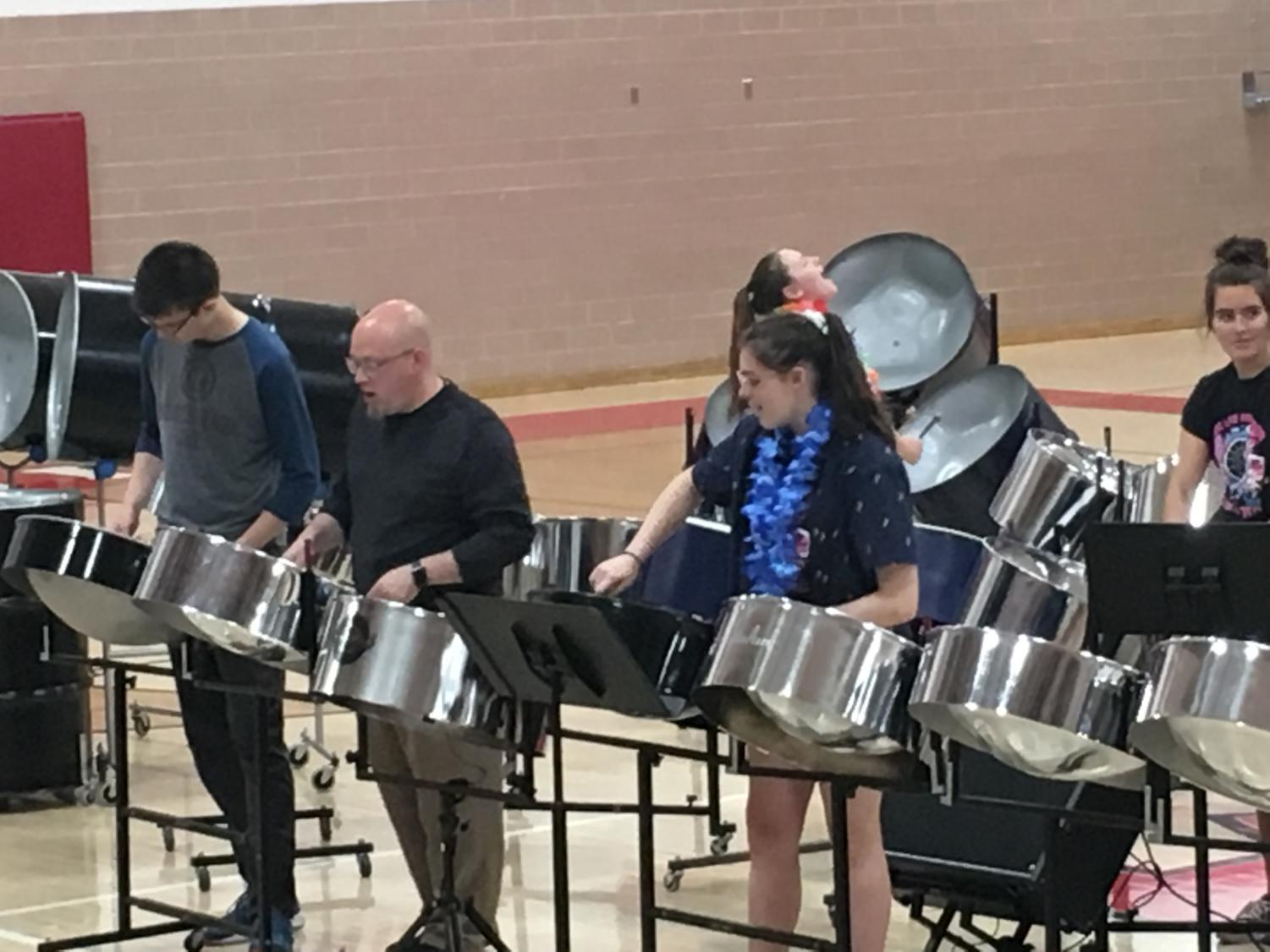 The St. Louis High School steel drum band performs for the school.