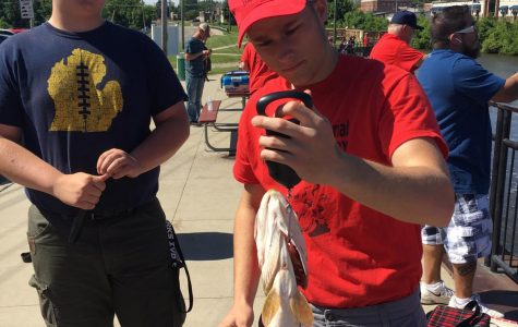 Andrew Musselman and Nicholas Worthy work to measure and weigh fish.