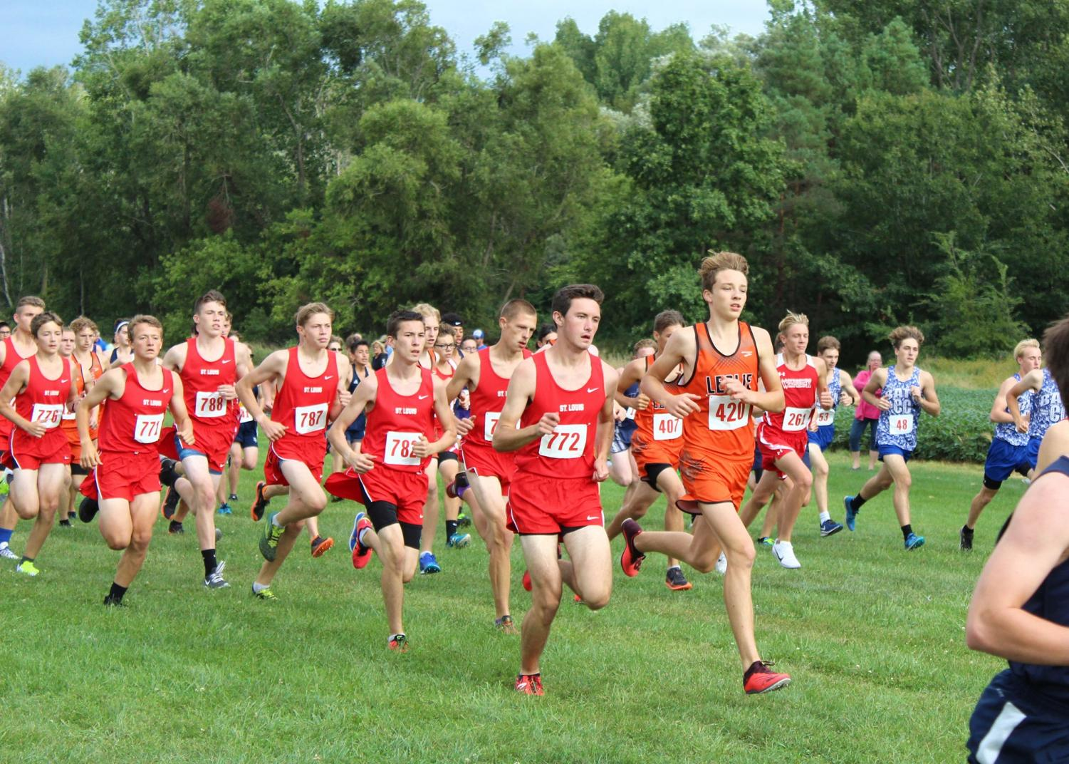 The boys' varsity starts the race as a pack.