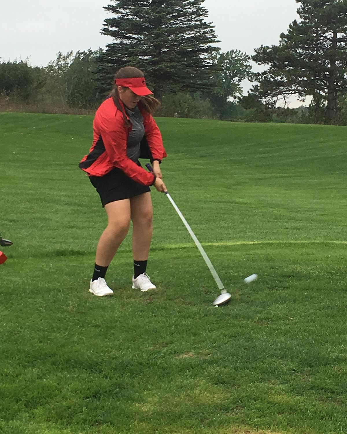 Mackenzie Strong drives the ball at the Alma Invite.