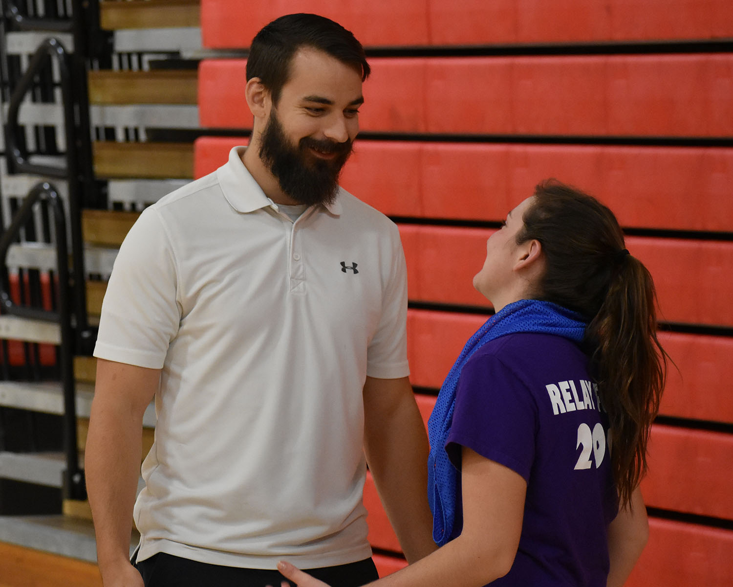 Mr. Landis interacts with a senior in P.E. class.
