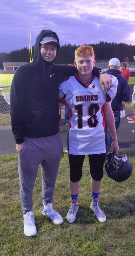 Reece+Giles+%28right%29+poses+with+older+Brother+Maverick+following+his+first+start+as+quarterback.