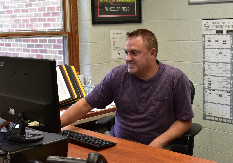 Mr. Hemker works in his office.