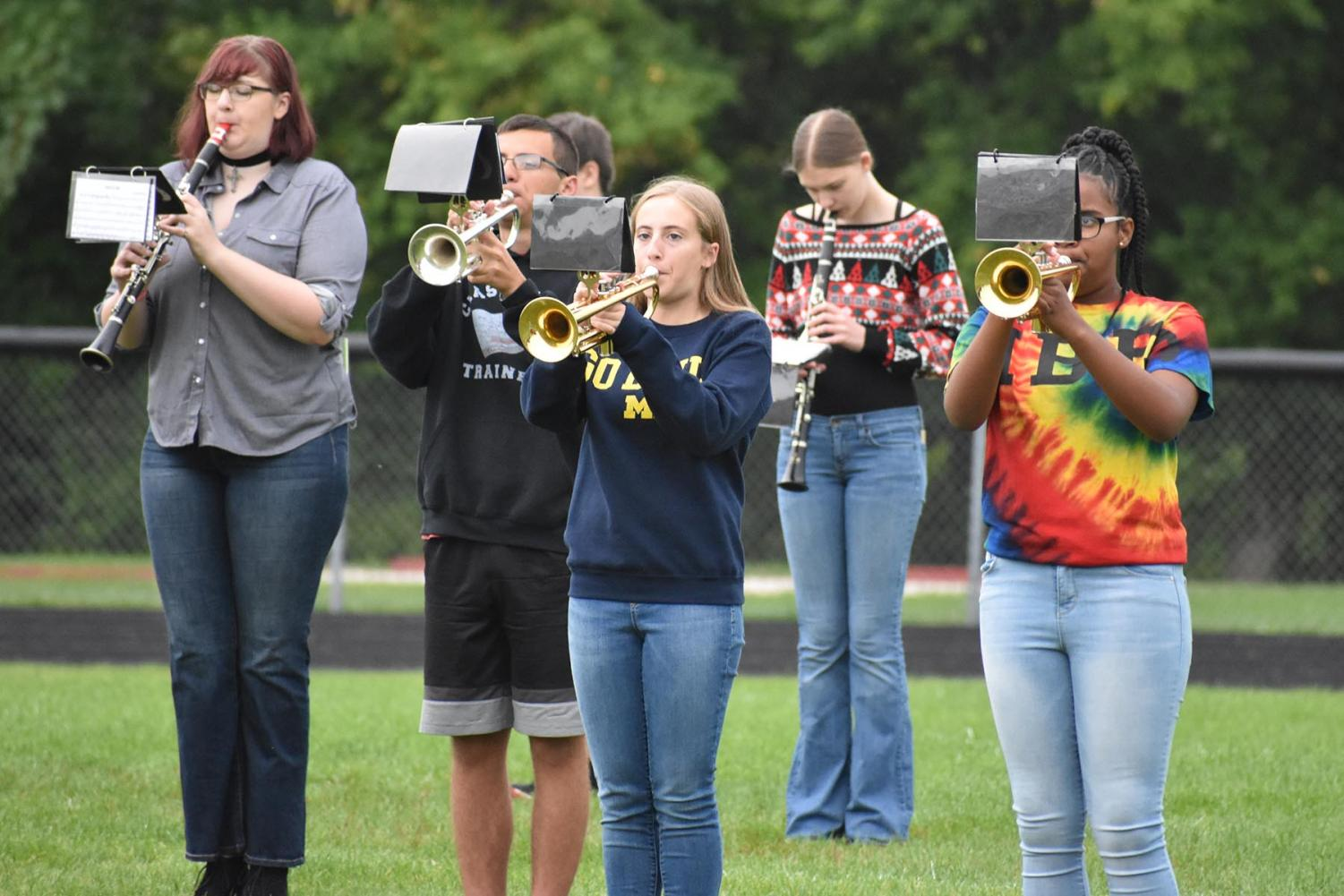 The marching band practices on the football field in preparation for Friday's games.