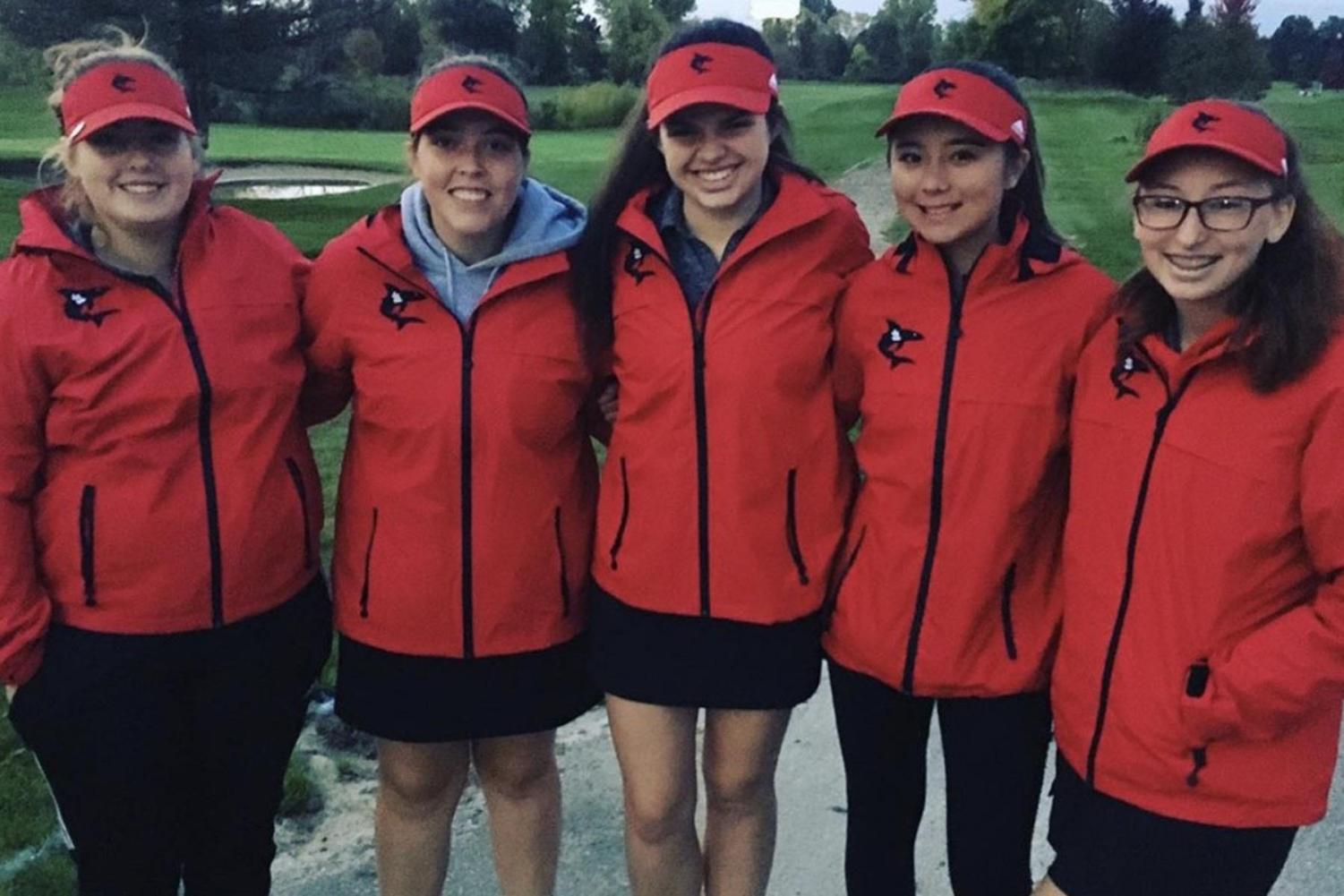 The girls golf team finishes season in the rain.