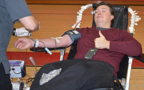 Eric Huff gives blood.