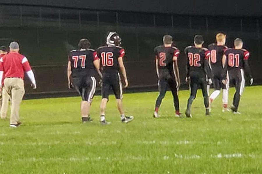The+seniors+take+their+final+walk+off+Wheeler+Field.