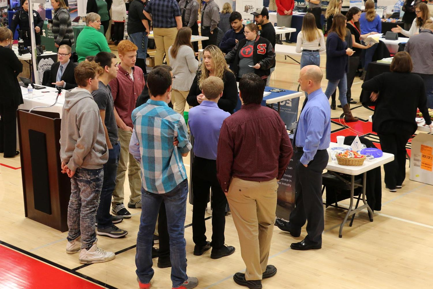 SLHS students talk to a variety of local businesses at the career fair.