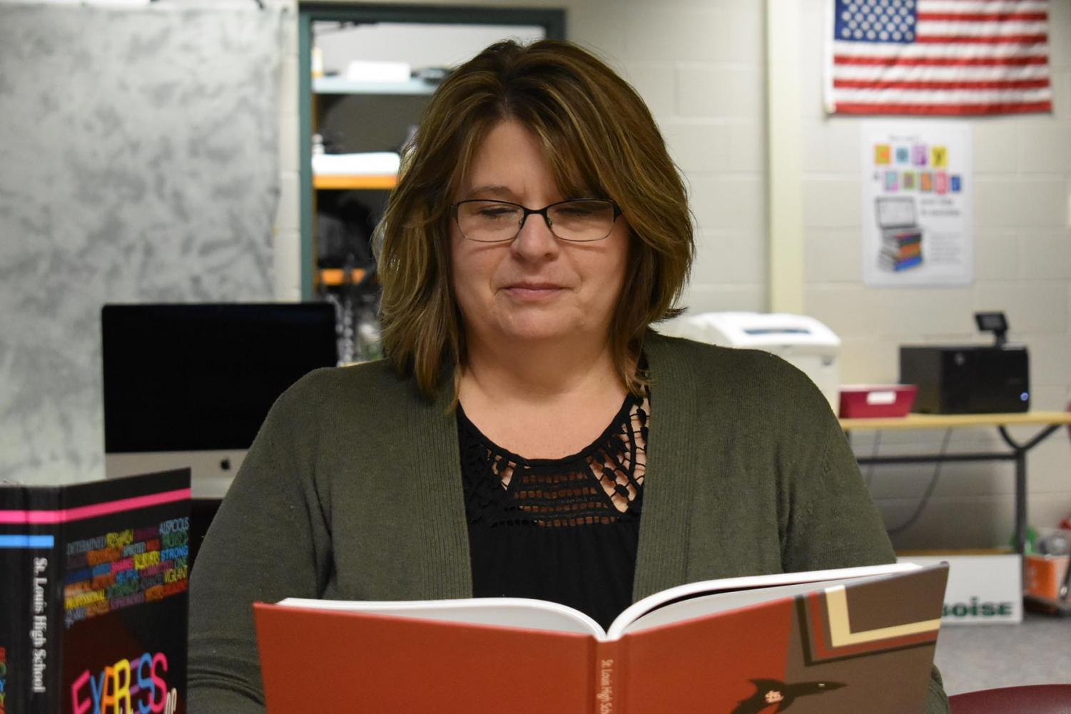 Mrs. Reeves takes pride in the annual publishing of the SLHS yearbook.