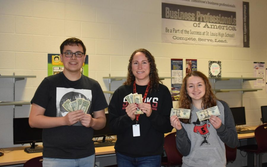 Mrs. Biehl teaches students about how to handle finance.