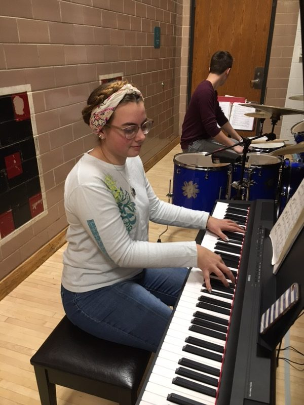 Jenna+Jewell+plays+the+piano+for+the+pep+band.
