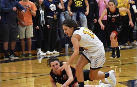 Both girls' basketball teams open with loss to rival