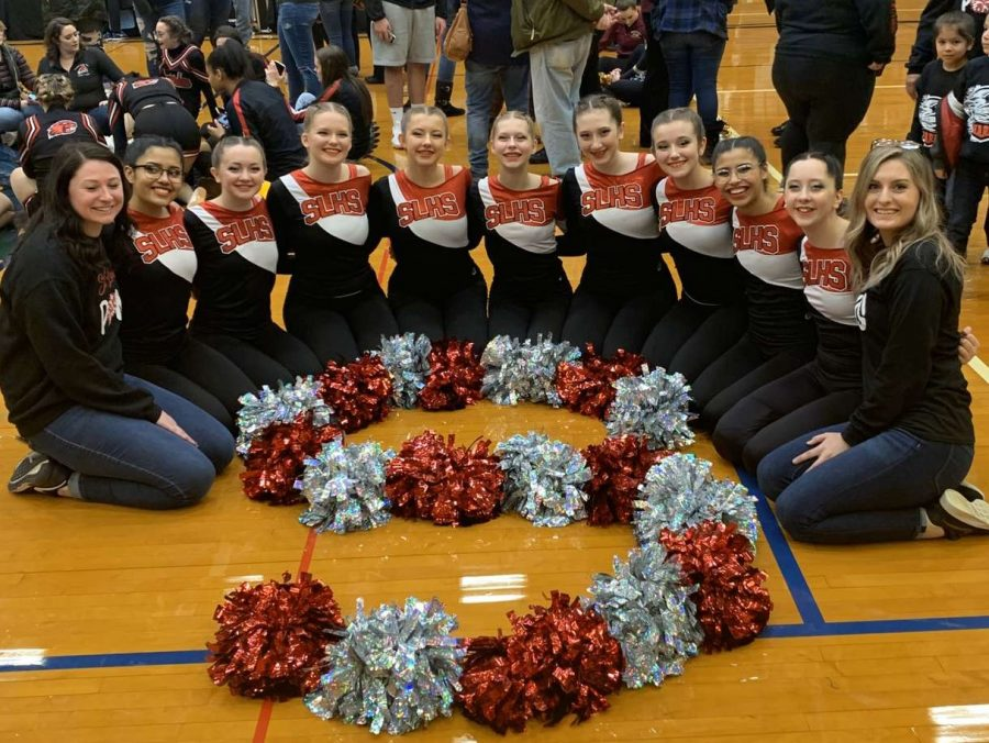 The+varsity+pompon+team+celebrates+after+their+performance+at+the+regional+competition.