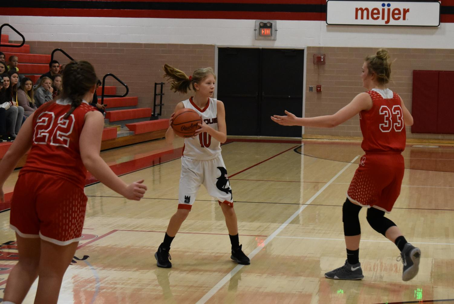 Mikaila Borie handles the ball while surveying the floor for open teammates