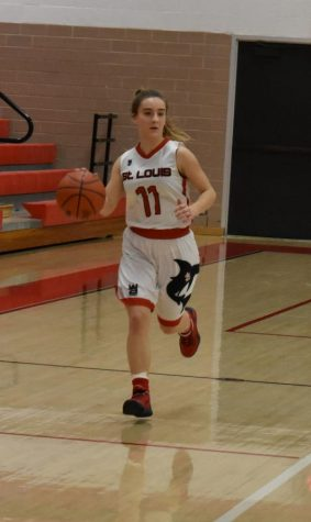 Senior Zoe Dickman brings the ball down the court.