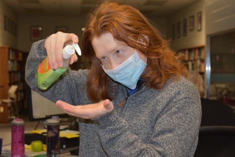 Logan Koutz demonstrates proper steps to stay safe from the raging Coronavirus.