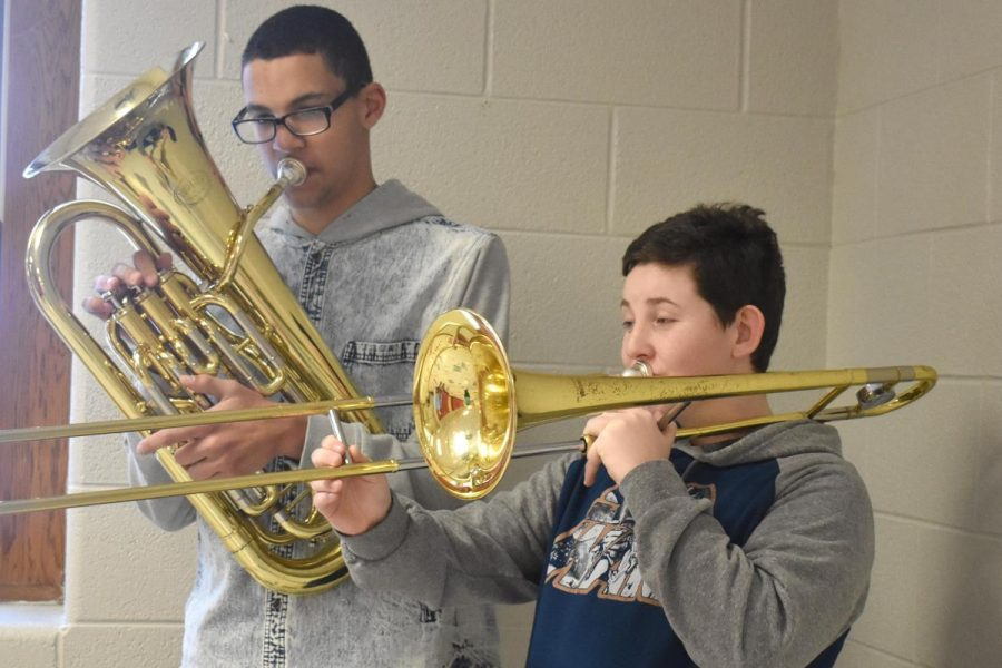 Demetrius Alspaugh (left) and Will Tuzas (right) practice for their performance.