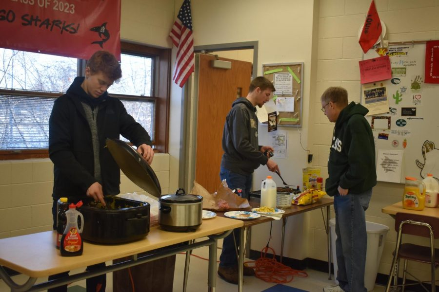 A few FFA members cook breakfast in Mr. Bernia's room during spirit week.