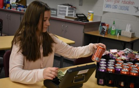 Student Council member Leah Chvojka sells crush pops to eager students.