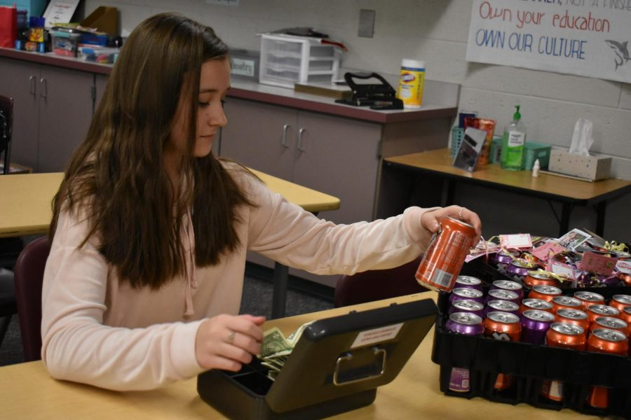 Student+Council+member+Leah+Chvojka+sells+crush+pops+to+eager+students.