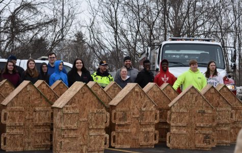 SLHS Wooshop built 26 miniature wooden houses to help local fire departments.