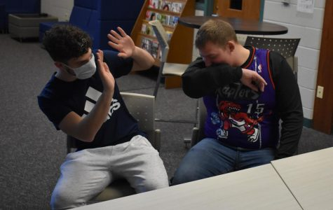 Cade Pestrue (left) and Luke Maxwell (right) demonstrate the spreading of the virus.